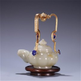 A Carved Jade Wine Pot with Handle