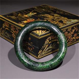 A Carved Jadeite Bracelet