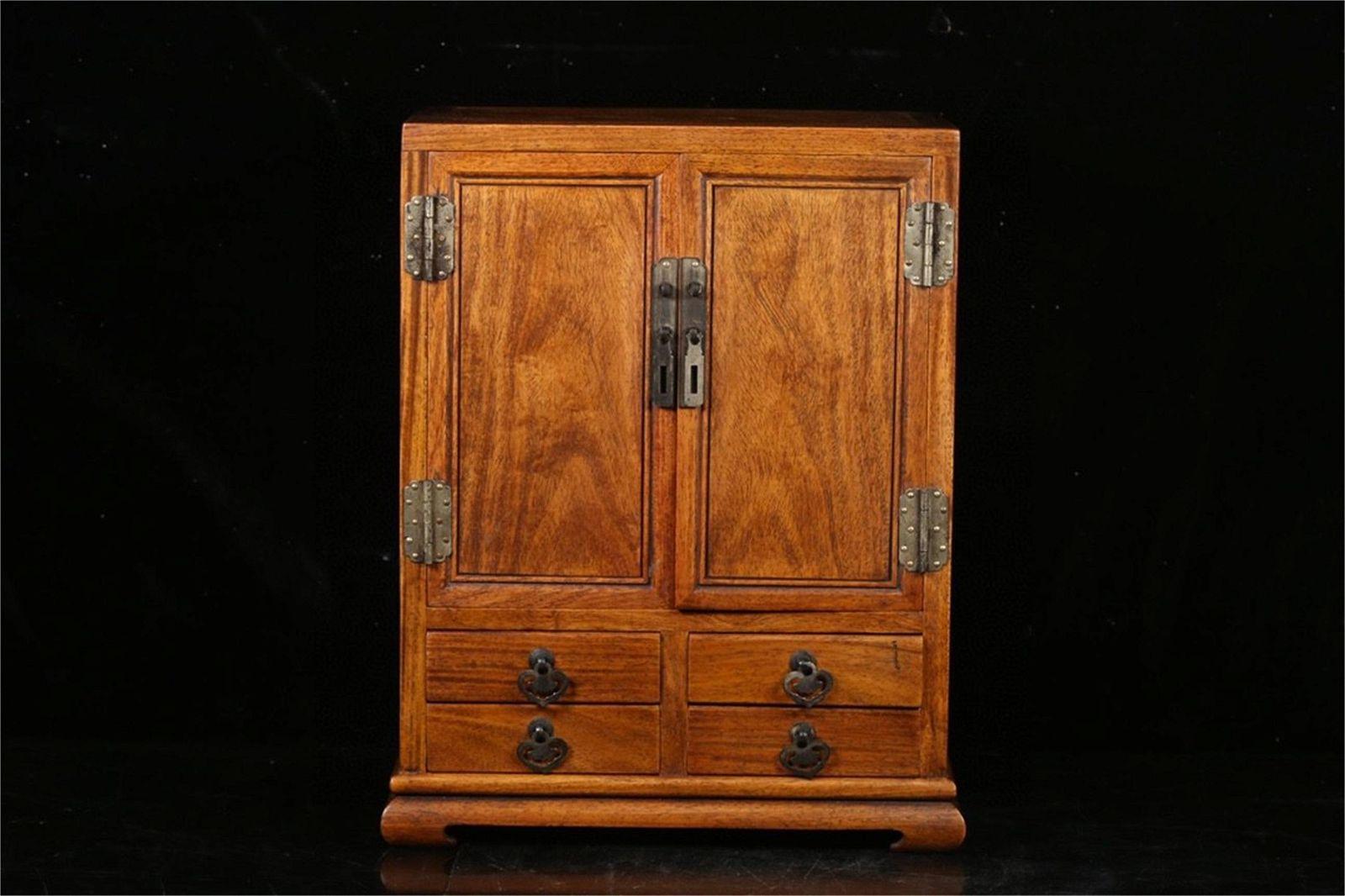 A Carved Hardwood Cabinet