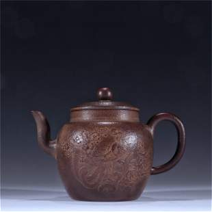A Carved Yixing Zisha Teapot with Phoenix Pattern