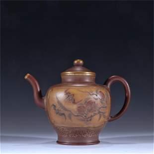 A Carved Yixing Zisha Teapot