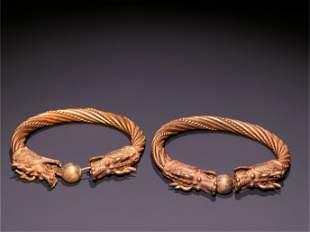 A Pair of Gilt Silver Bracelets