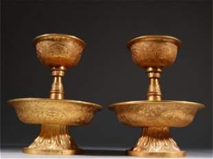 A Pair of Gilt Bronze Candlesticks