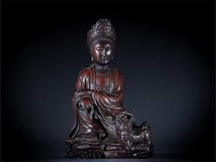 A Carved Zitan Wood Guanyin Statue