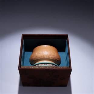 A Yellow Glazed Porcelain Jar with Beast Pattern