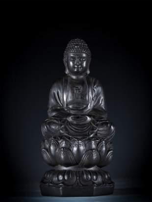 A Carved Zitan Wood Buddha Statue