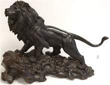 Bronze oriental lion figure signed with oriental cipher
