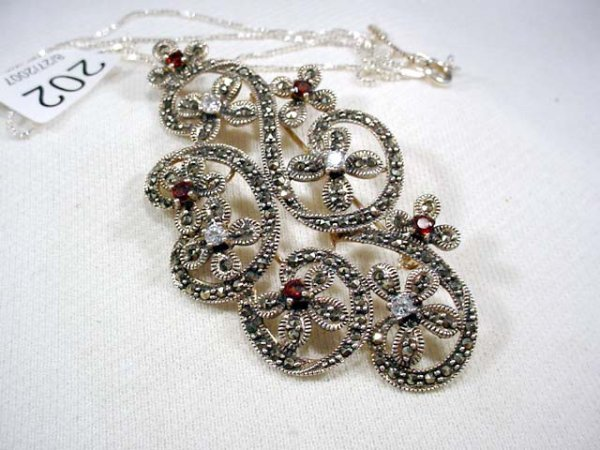 202: Antique style sterling pin or pendant, marcasite