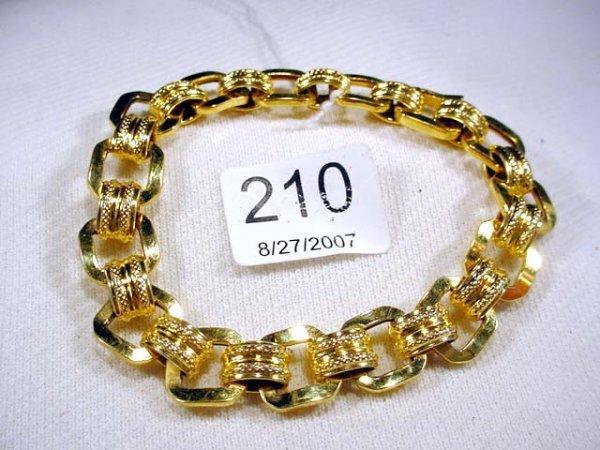 210: 7 inch 14K wide link bracelet, 8.2 gr
