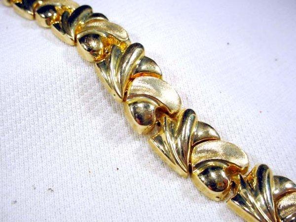 211: 14K designer style bracelet, 17.9 gr
