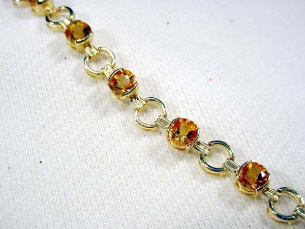 212: 7 1/2 inch 14K bracelet set with round citrines