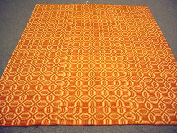 1012: Woven coverlet with unusual orange color woven in