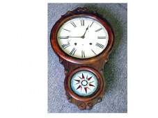 1500 Early rosewood cased wall clock with reverse