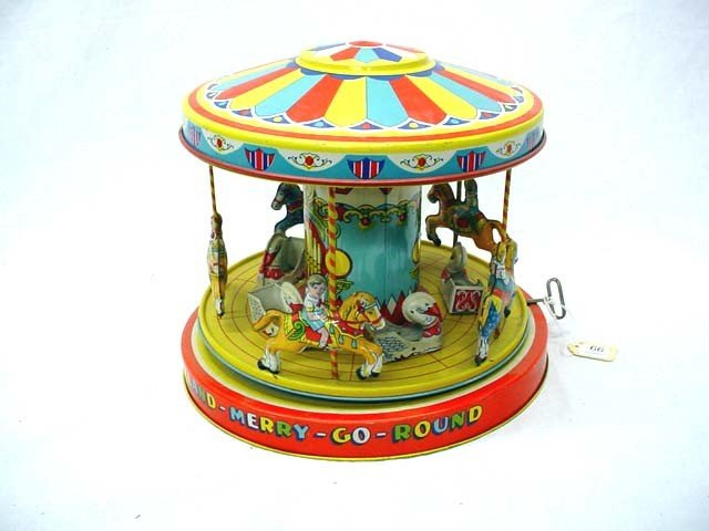 12: J Chein & Co Playland wind up merry-go round