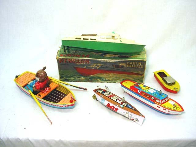 18: 5 toy boats including penguin cabin cruiser