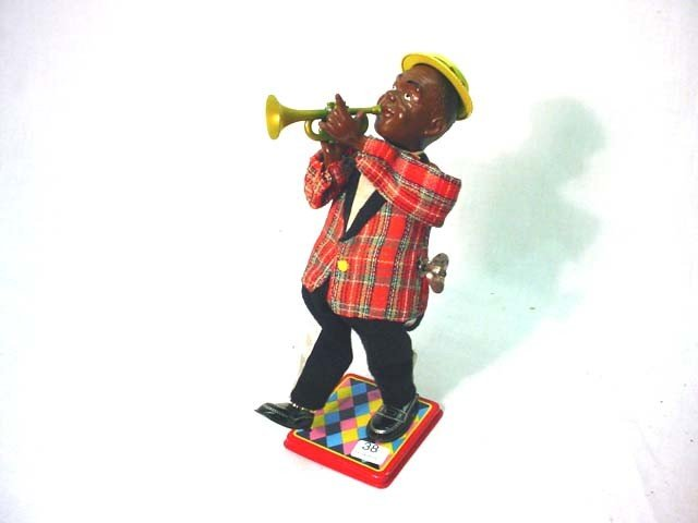 38: Louis Armstrong wind up toy