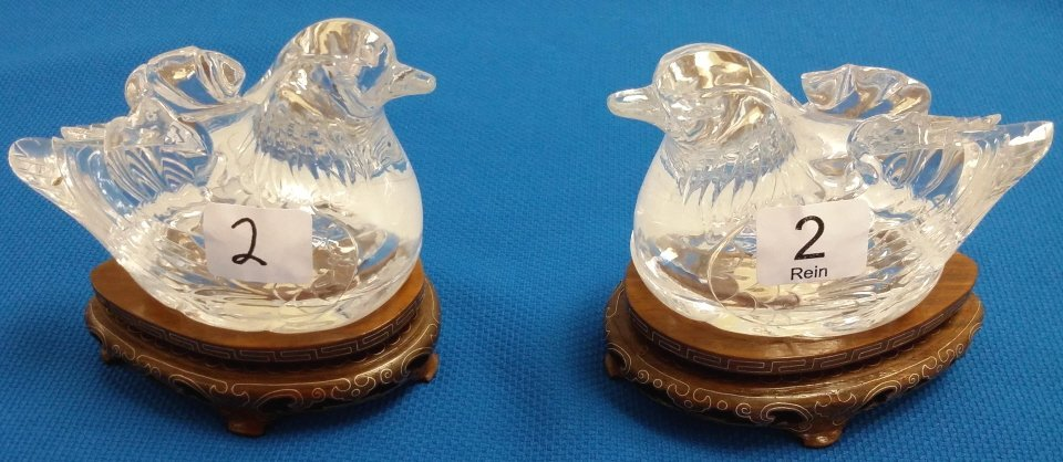 "2- 3 1/2"" carved rock crystal bird boxes with stands"