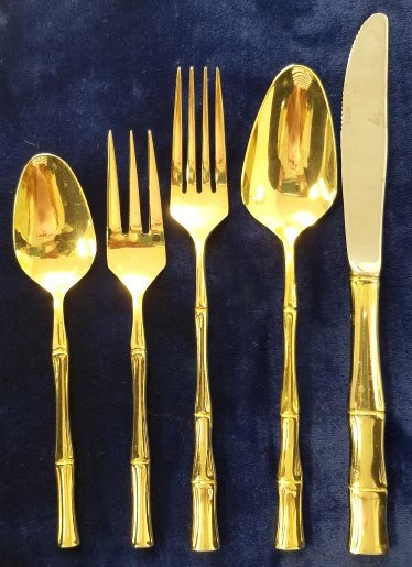 Group gold plated flatware