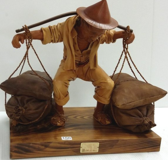 "16""x 15"" signed leather sculpture 18/50- The Bearer"