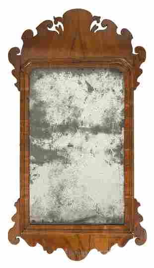 CHIPPENDALE MIRROR Mahogany and mahogany veneer frame.