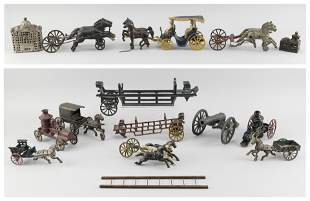 ELEVEN CAST IRON TOYS, MOSTLY HORSE-DRAWN 1)