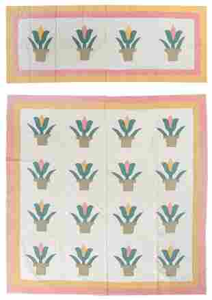 QUILT AND TWO MATCHING PILLOW COVERS IN TULIP PATTERN