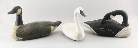 THREE WATERFOWL ITEMS A cast metal swan in decoy form,