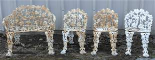 ASSEMBLED FOUR-PIECE SUITE OF CAST IRON GARDEN SEATING