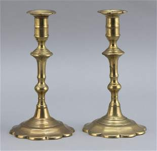 PAIR OF CONTINENTAL BRASS PUSH-UP CANDLESTICKS Late