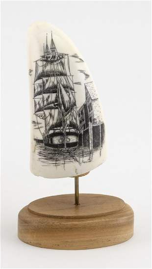 * ENGRAVED WHALE'S TOOTH DEPICTING A SHIP AT DOCK 20th
