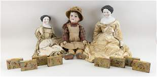 THREE GERMAN DOLLS AND EIGHT LITHOGRAPHED WOODEN