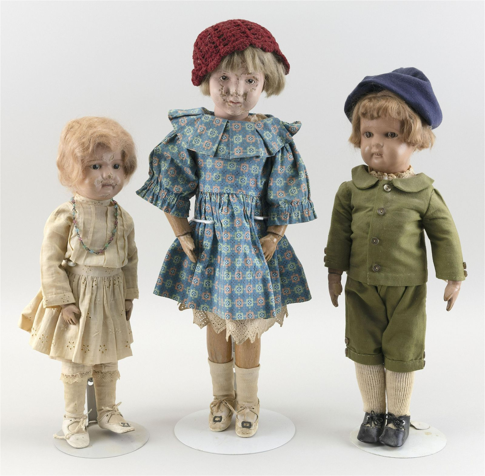 THREE SCHOENHUT WOODEN DOLLS