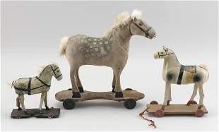 THREE GERMAN COMPOSITION AND WOOD HORSE PULL TOYS