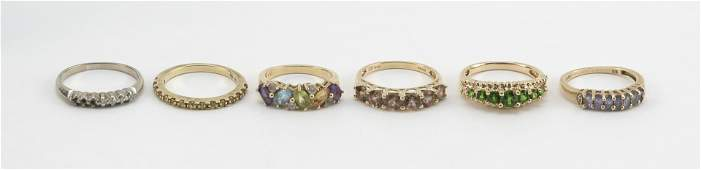 SIX GOLD AND GEM-SET RINGS Five 14kt gold and one 10kt