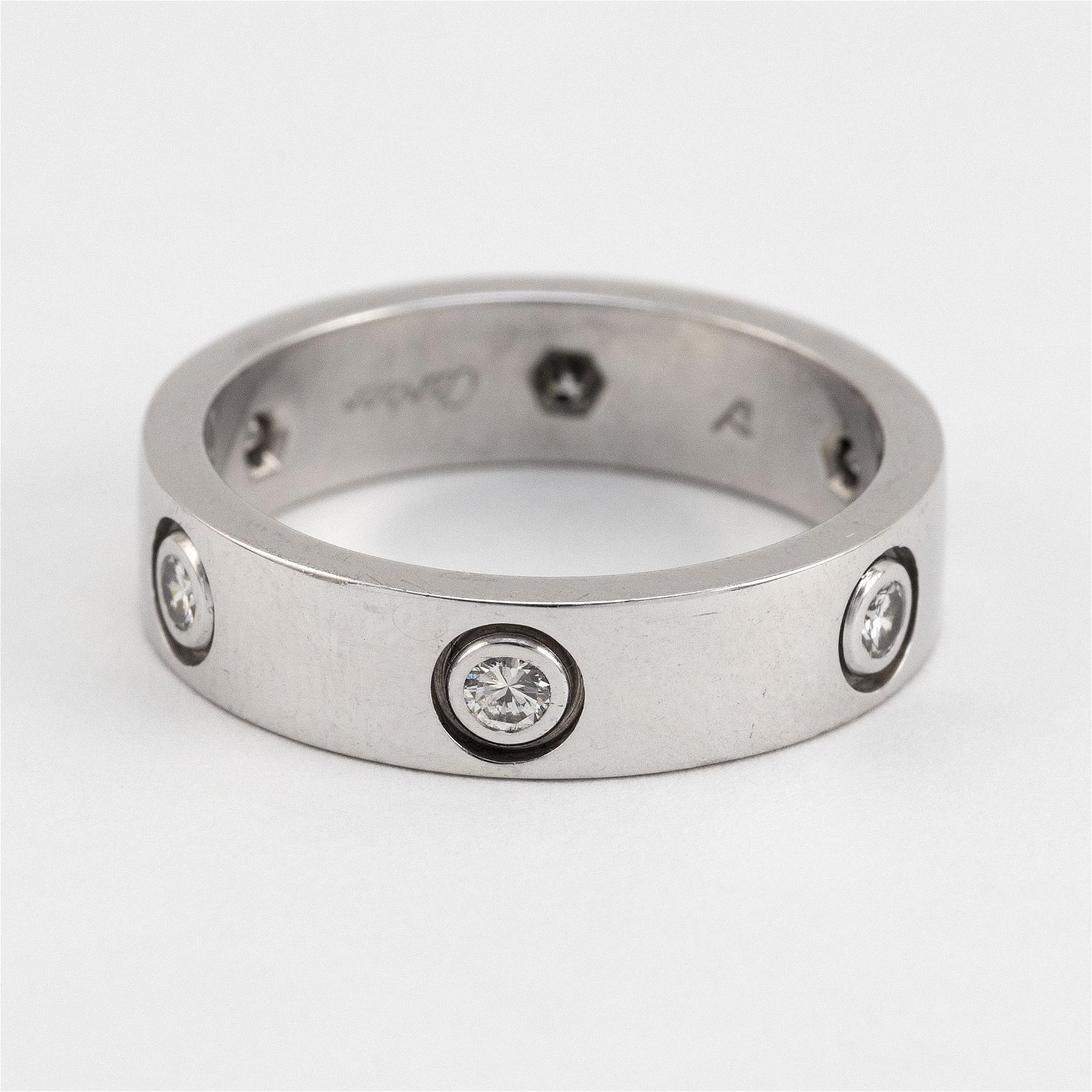 """CARTIER """"LOVE"""" 18KT WHITE GOLD AND DIAMOND RING"""