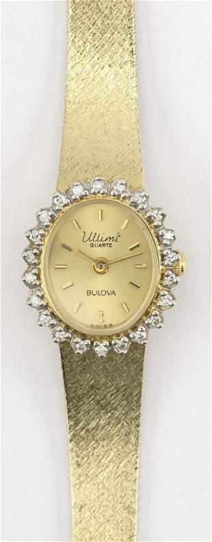 VINTAGE BULOVA 14KT GOLD AND DIAMOND WOMAN'S WATCH