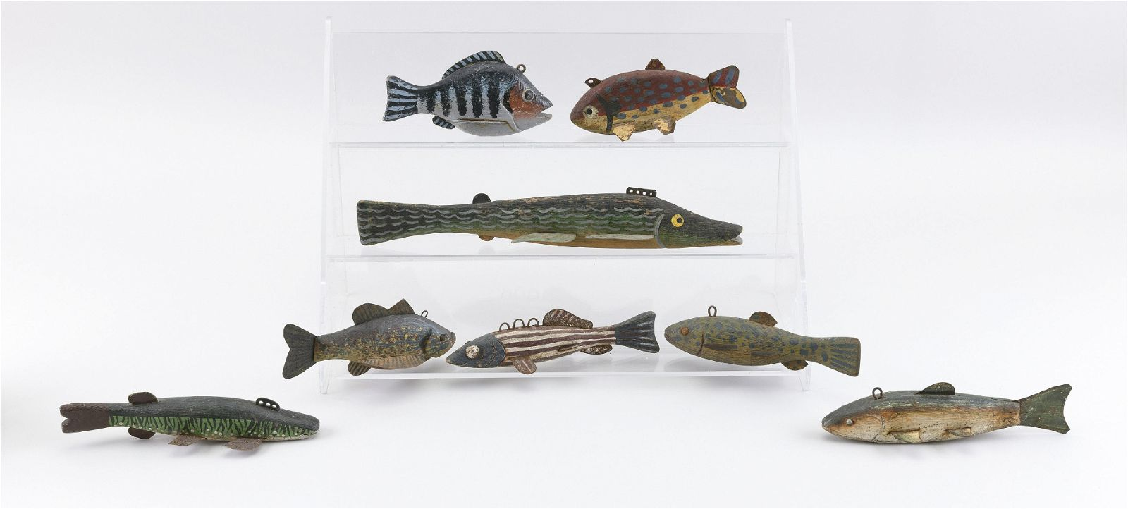EIGHT VINTAGE FISH DECOYS Mid-20th Century Lengths from