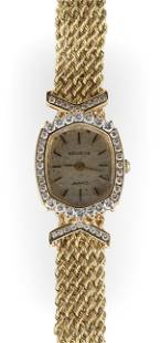 14KT GOLD AND DIAMOND WATCH Approx. 15.48 total dwt.