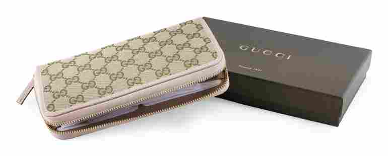 GUCCI ZIP-AROUND WALLET IN LOGO CANVAS WITH PINK