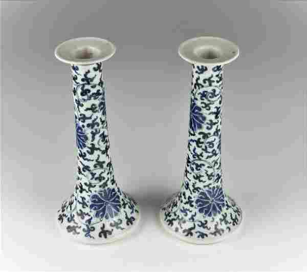 A PAIR OF CHINESE BLUE AND WHITE CANDLE HOLDERS