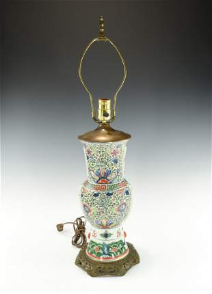 A CHINESE FAMILLE VERTE VASE CONVERTED LAMP