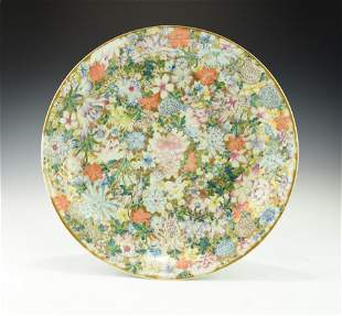 A LARGE CHINESE FAMILLE ROSE MILLEFLEURS PLATE