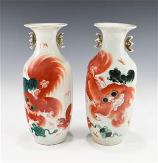 A PAIR OF FAMILLE ROSE AND IRON-RED DECORATED VASES