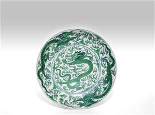 A CHINESE GREEN ENAMEL DRAGON DISH