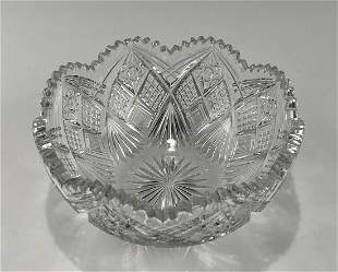 A LARGE HAND CUT CRYSTAL BOWL