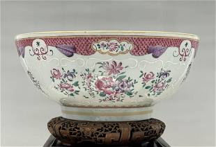 A LARGE QIANLONG STYLE ARMORIAL FAMILLE ROSE BOWL