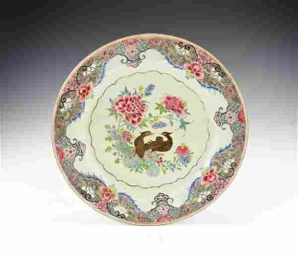 A LARGE YONGZHENG PERIOD CHINESE FAMILLE ROSE PLATE