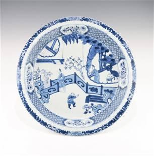 A LARGE KANGXI PERIOD CHINESE BLUE & WHITE SHALLOW BOWL