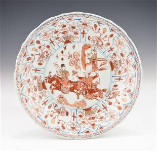 A KANGXI PERIOD CHINESE IRON-RED ENAMELLED PLATE