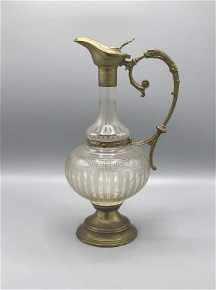 A chrystal cut mounted decanter